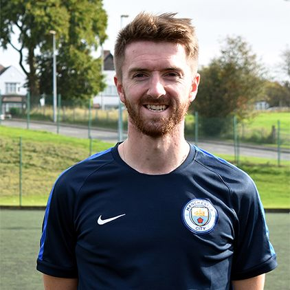 Man City coach goes back to college