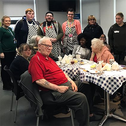 Pensioners go back to college for tea with students