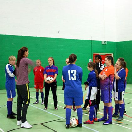 ​England star shares skills with aspiring female footballers